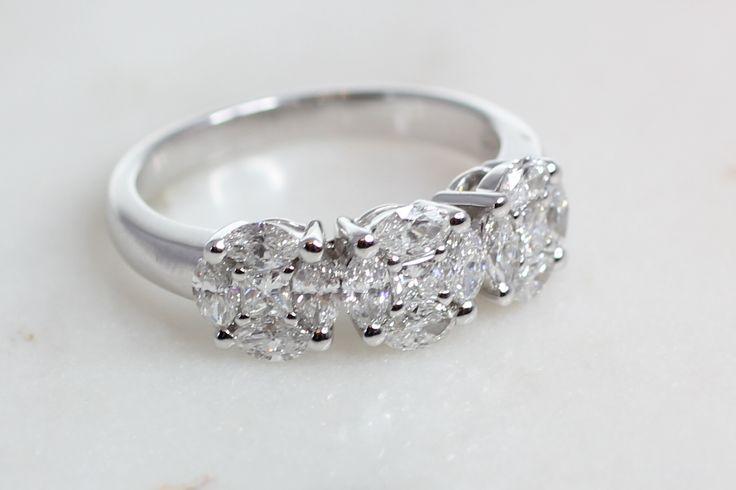 Three cluster diamond ring.