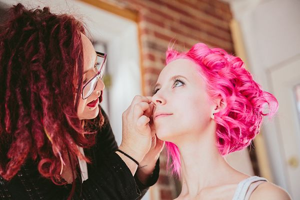 Pretty in Pink: There are more boxes than just brunette, blonde, and redhead these days. With hair colors running the gamut from lavender gray to technicolor tangerine, colorful brides are strolling down the aisle in style.  We love the loud pink curls on this bride.