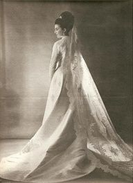 Princess Anne of France, Princess of Orléans married Carlos of Bourbon-Two Sicilies, Duke of Calabria on May 12, 1965, at Dreux, France. The bride wore a Balmain silk gown of Lyonnaise lace, embroidered with fleurs de lys. The wedding dress was designed by Pierre Balmain. The veil is really gorgeous, it was worn by the couple's four daughters when it was their turn to get married and three of the daughters also wore their mother's wedding gown.