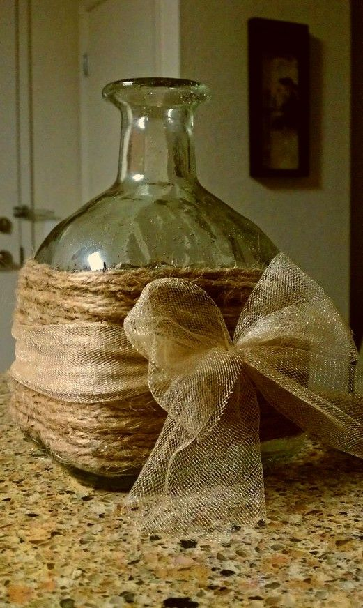 upcycle old wine or hard liquor bottles- Good idea! Wrapped in burlap (or jute cord), and tied with a sparkly iridescent tulle ribbon!