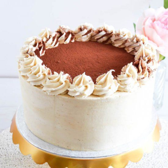 This tiramisu cake is layers of coffee soaked genoise sponge filled with mascarpone cream and frosted with espresso buttercream.