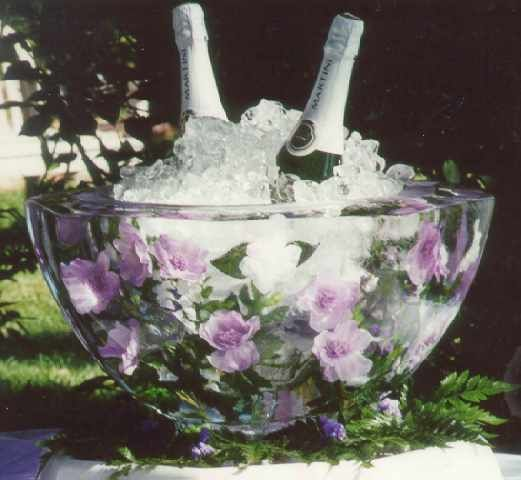 Ice bowl with fresh flowers ~  made these for many years - trick to getting nice clear water is boiling the water first and letting it cool...then making the ice bowls. Works with flowers, herbs, leaves, toys, anything! we made it once with doll body parts and the hands sticking out/faces smashed against the ice for Halloween