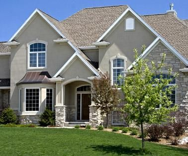 Northalnd stucco plaster stone and brick mpls for Stucco and brick homes