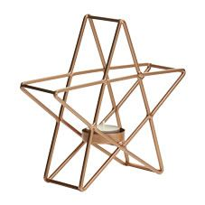 Illuminate your home in style with this gorgeous copper star-shaped tealight holder. This striking accessory would look great on a sideboard or your mantelpiece and will hold one tealight.