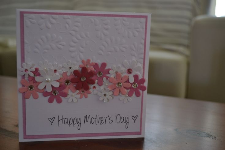 Love this style - floral embossing on the top half of the card, with a freestyle garland of flower pieces in a variety of sizes and centers, from brads to pearls on this handmade mother's day card.