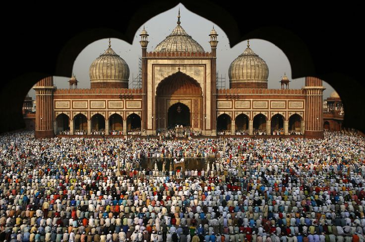 Indian Muslims attend prayers during the Eid al-Fitr festival at The Jama Masjid Mosque in New Delhi