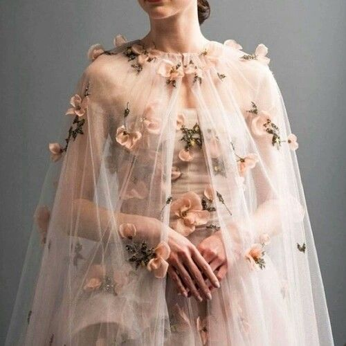 omggg this reminds me of belle's wedding dress from the live-action batb