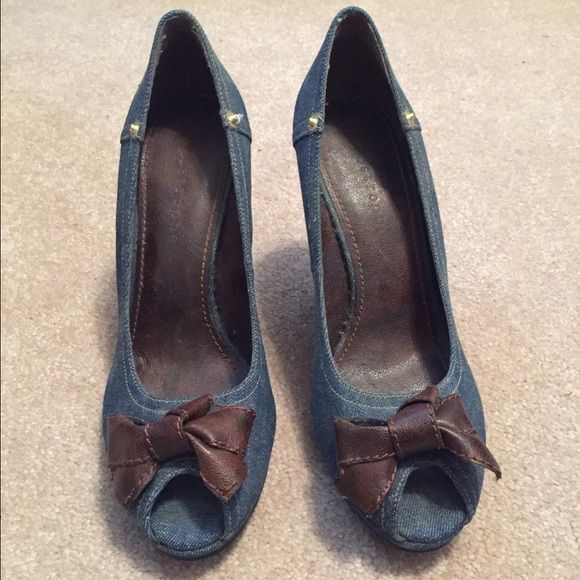 Never worn denim heels size 9 Never worn denim heels. Brown leather bow accent. Wedge heel height approx 3 inches. Metaphor Shoes Wedges