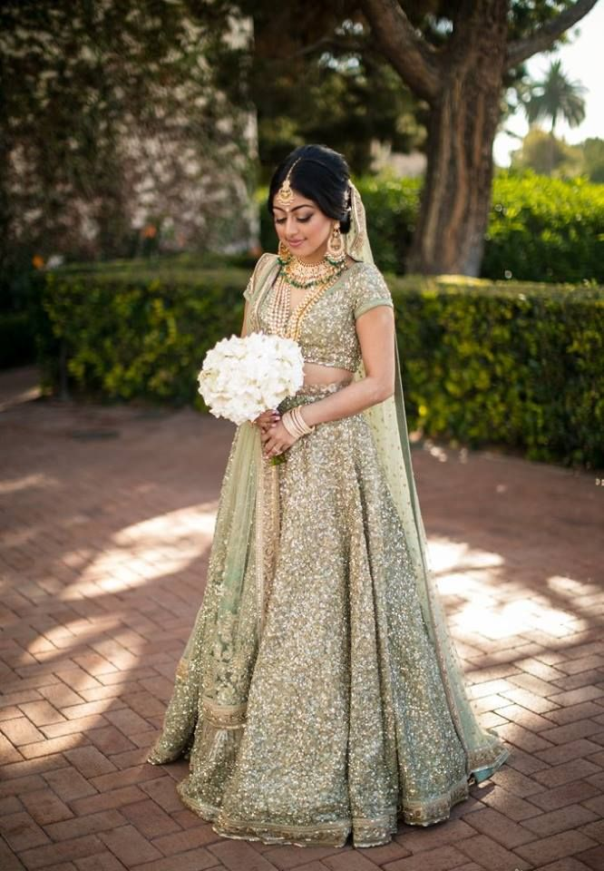 A mint green lehenga completely covered with gold sequence by Sabyasachi for Bride Meena of WeddingSutra. #weddingsutra #bridallehenga #lehenga #Indianbride #Indianoutfit #bridallook #weddingideas #desibride #bride #bridaloutfit #designer #sabyasachi #green #gold Photo Courtesy- Lin & Jirsa Photography
