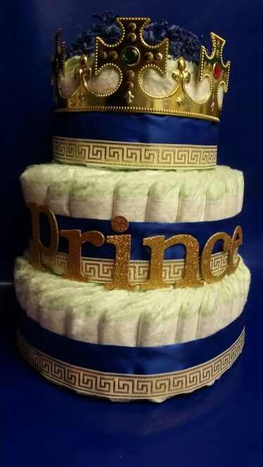 Royal prince diaper cake, the diapers can be rolled differently this can be done for mom and dad to be table , with the smaller diaper cakes and centerpieces for the others