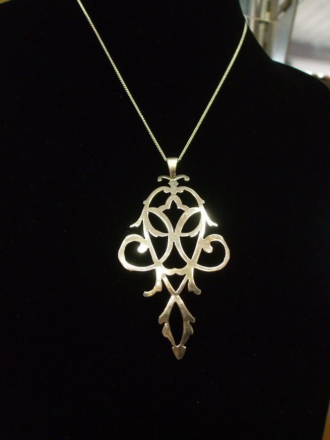 Beautiful unique pendant cut from an old candy dish.  Truly a one of a kind piece!  Email info@ucao.ca for availability.