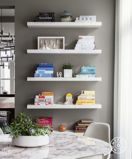 Chic and Modern in Chicago - Shelf arranging is the art of restraint – minimize for maximum impact. by Homepolish Chicago https://www.homepolish.com/mag/chic-and-modern-in-chicago?gallerize=9bd1e26d