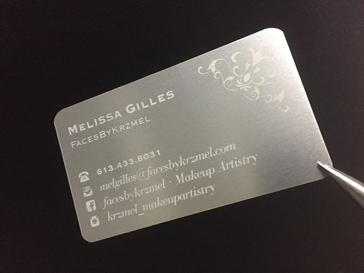 silver metal business card with a silver engrave finish really classy and elegant