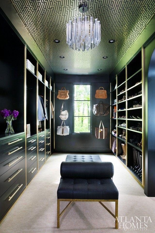 glamorous dark walk in closet, brass hardware, glass light