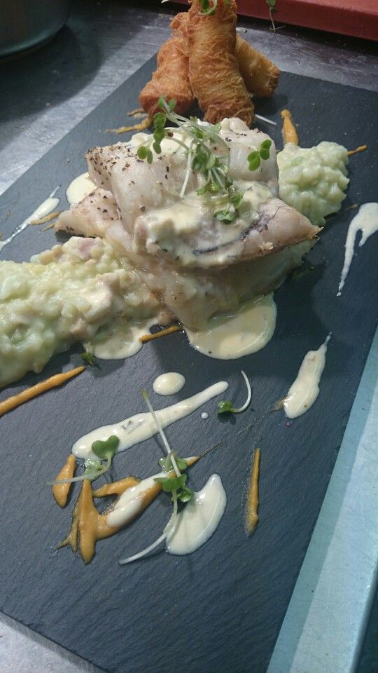 Grilled hake, kataifi prawns, pea risotto, butternut squash and citrus cream.