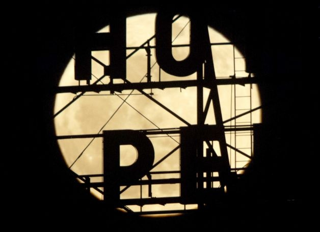 """Might be my fave ... A """"supermoon"""" appears above the temporarily closed Hotel Pere Marquette on Saturday, May 5, 2012, in Peoria, Ill."""
