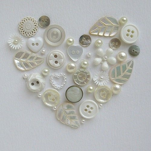 Cute idea... Use old buttons to create a heart shape like this, sew em onto a top....