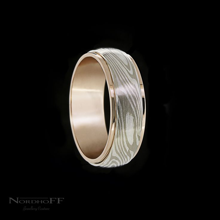 This striking gents wedding ring was made by Sam using the ancient Japanese technique called Mokume Gane, which is a process of layering and bonding different precious metals to give a wood grain effect. Every ring is unique.