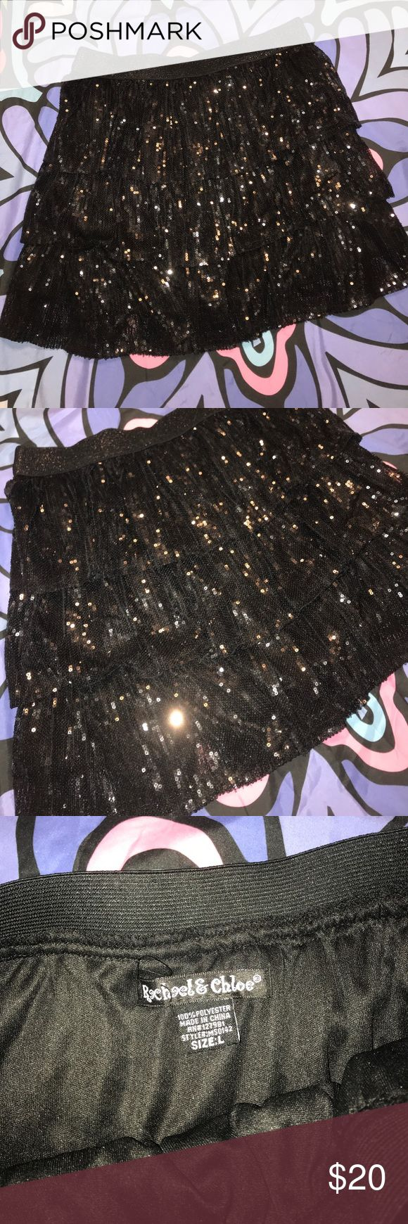 Sparkle Mini Skirt Black sequins mini skirt, brand new and never worn. Has a cute lil ruffle style to it! The band is elastic so it has TONS of stretch. Tags: rag & bone nasty gal UNIF dollskill American apparel Tobi Charlotte Russe h&m lf free people forever 21 Bebe dolls kill classy American Eagle Hollister billabong la Hearts Kendall and Kylie lf express John galt pacsun Charlotte Russe Skirts Mini