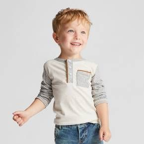 Your toddler will be the talk of the town in this Toddler Boys' Long-Sleeve Henley Shirt from Genuine Kids® from OshKosh®. The soft oatmeal color will go with almost any bottoms, whether you're dressing him up for a special occasion or keeping him casual for playtime.