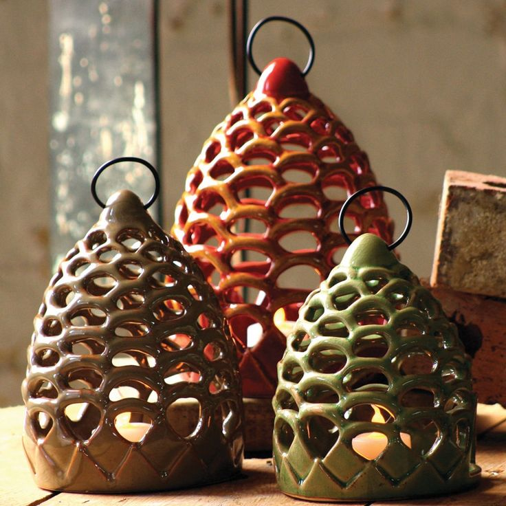@Erin B Rohde Pinecone Lanterns I can't remember if you still do this decor.