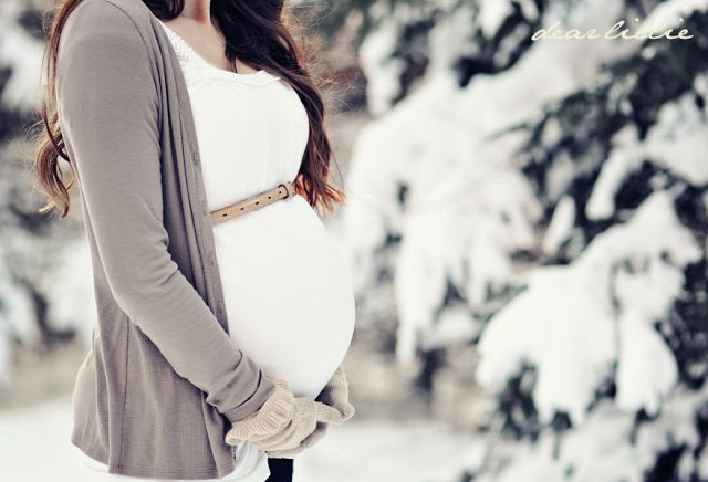 Winter maternity shoot - belted above the belly, coordinating gloves