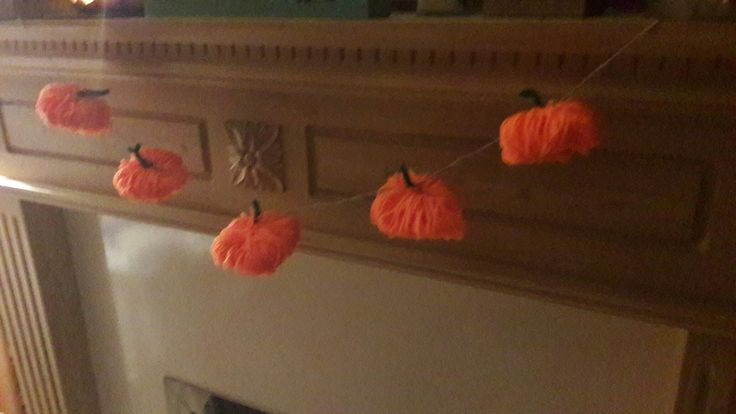 Pumpkins! Yarn and pipecleaners  on twine. Got the instructions at  http://www.designimprovised.com/2013/09/halloween-crafts.html?m=1