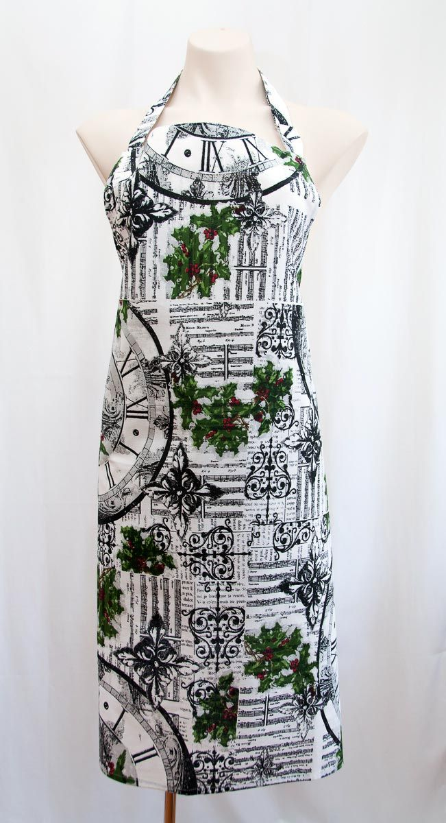 This designer apron is not only for Christmas time, the mistletoe design gives the cook that wears this apron unlimited kisses on demand thanks to the mistletoe cunningly hidden in the design! This is a really lovely print in crisp white with black sheet music, clocks and wrought iron images. And the subtle green mistletoe with red berry lift the whole design to a new level of coolness. The size is approximately 70 x 90cm and this is a quality cotton fabric. Available from Gorgeous…