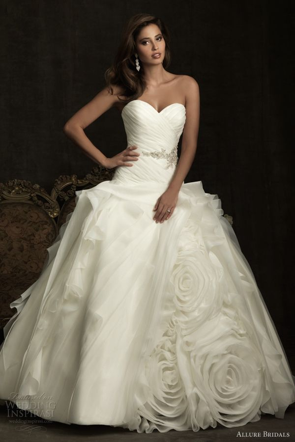 Strapless ball gown with ruched bodice and a Swarovski crystals belt The skirt is layered with ruffles and rosettes of organza and tulle. Allure bridal
