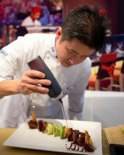 Putting the finishing touches on the sushi #royalcaribbean