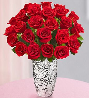 Two Dozen Red Roses + Free Vase. Surprise that special someone who makes you smile with our stunning bouquet of two dozen fresh red roses. Order today and for a limited time, get a Free clear glass vase with purchase. This elegant arrangement is a truly thoughtful gift for birthdays, anniversaries or just to show how much you care. Save 20% with the coupon code ABENITY at http://www.1800flowers.com.