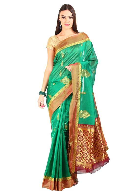 This bottle green silk saree is made of pure silk. The rich zari pallu and border of this bottle green silk saree makes it even more delightful to wear. You can wear either gold or maroon or green blouse with this lovely bottle green silk saree and accesorize with flexibility. Buy it here with 40% Off: https://silkshari.com/producttag/360/green-silk-saree-blouse-designs-catalogue