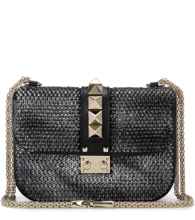 Valentino - Valentino Garavani Lock Small leather shoulder bag - This glittering dainty style is the newest addition to the cult family of Valentino Garavani's Lock bags. Crafted from smooth black leather, the design is embellished with sequins for a party-ready appeal, the silver-tone studs offer timeless allure. Let yours elevate a simple black dress. seen @ www.mytheresa.com