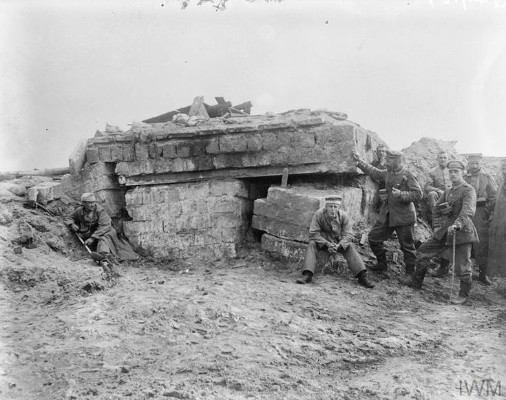 Men of the German Naval Corps in Flanders. A new dug-out destroyed by trench-mortar shell. Date unknown.