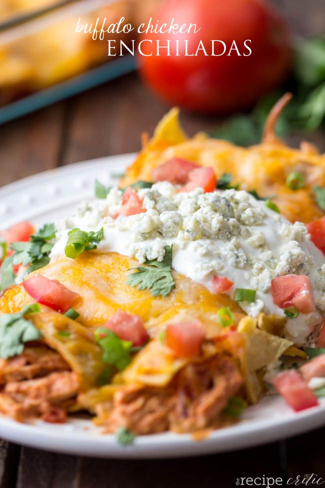 Buffalo Chicken Enchiladas are absolutely incredible with a creamy buffalo chicken inside!
