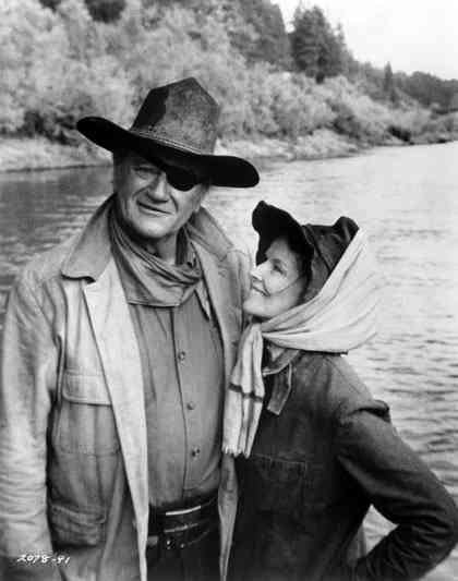 """Rooster Cogburn (John Wayne) to Eula Goodnight (Katharine Hepburn): """"Ma'am, I don't know much about thoroughbreds - horses or women! Them that I did know, I never liked. They're too nervous and spooky; they scare me. But you're one high-bred filly that don't. 'Course, I don't know what you're talking about half the time!"""" -- from Rooster Cogburn (1975) directed by Stuart Millar"""