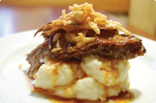Slow cooker beef brisket over garlic parmesan mashed potatoes. Perfect fall meal.