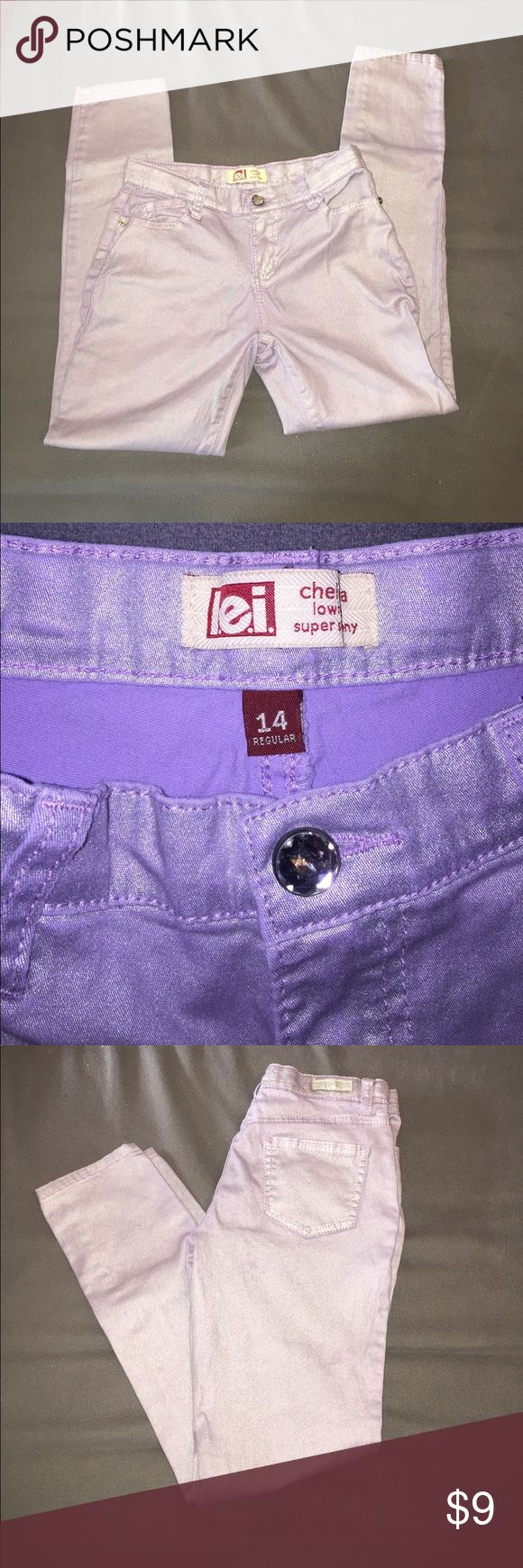 Light purple skinny jeans with sparkles Super cute skinny jeans. Smoke free home. In good condition. lei Bottoms Jeans