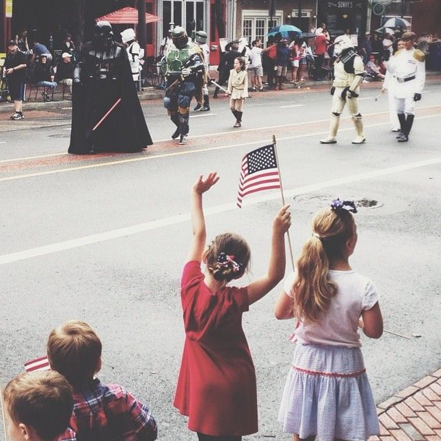 "Children cheer as the Wawa Welcome America Independence Day Parade moves along Market Street through ""the nation's most historic square mile."" (Photo by M. Stanley for Visit Philadelphia)"
