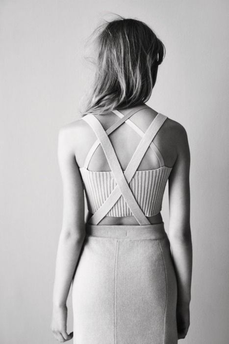 Love the use of straps to create detailing to the back