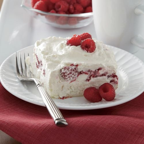 """Raspberry Whip Cake - 1 angel food cake (broken into 1"""" bits). 1 8-oz. carton of Cool Whip. 1 c. sour cream. 1 c. powdered sugar. 1 pint red raspberries (well drained, fresh or frozen).   In a medium bowl, mix together the Cool Whip, sour cream and powdered sugar. Fold in raspberries. Place all the angel food bits in the bottom of a 9"""" x 13"""" baking dish. Pour the raspberry mixture over the cake. Cover the pan with plastic wrap and refrigerate one hour.  An awesome summertime favorite.  :)"""