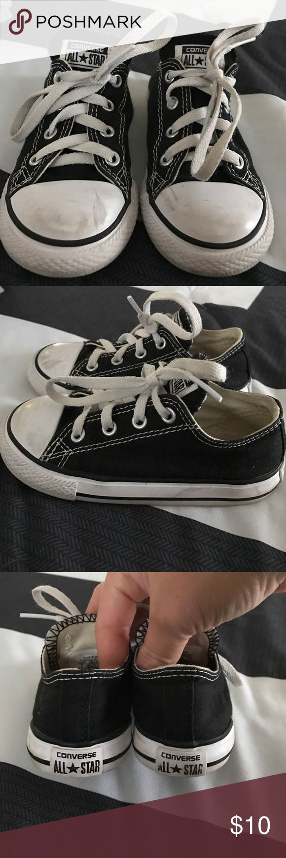 Toddler Boy's size 8 low top Converse In great condition - toddler boy's size 8 low top canvas black converse (chuck Taylor's) use a warm rag and soap to clean the sole And white toe of shoe. Converse Shoes Sneakers