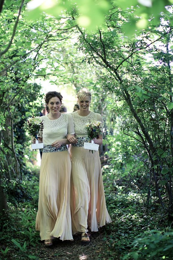 Bridesmaids in peach maxi skirts {bespoke} and chiffon daisy tops from Topshop...