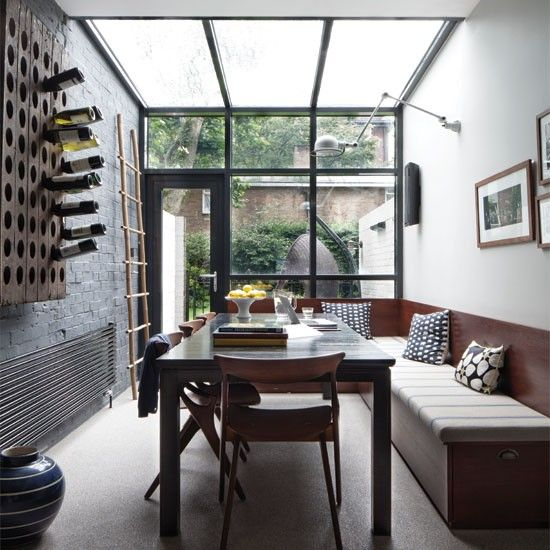 Dining area in a five storey townhouse in London. Really like the bench seating and the wine rack. (photo Christoffer Rudquist)