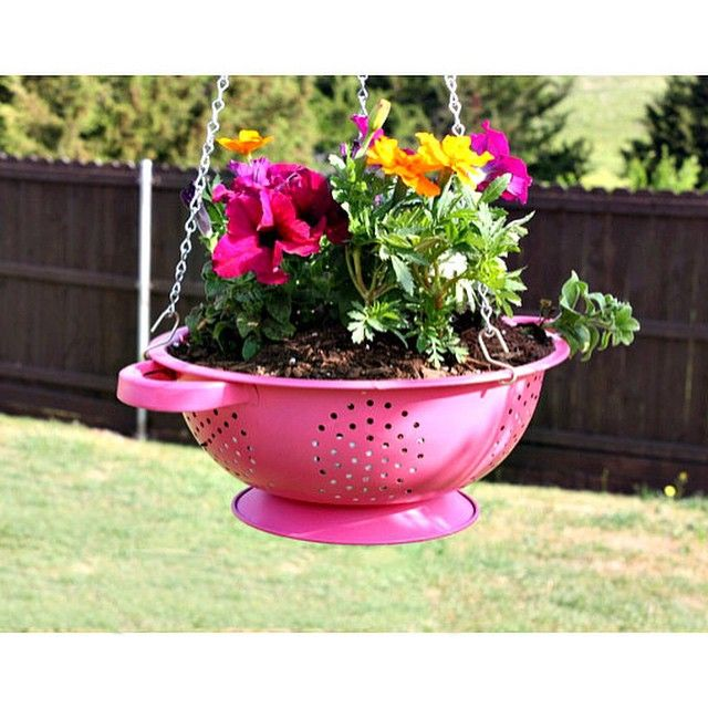 Give your summer blooms a fun & funky home with this cool #DIY Hanging Colander Planter idea. Purchase them now through the link in our profile. #SummerRefresh