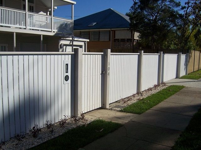 Vertical picket front feature fence with exposed posts and capping with pedestrian gate and letterbox. Styles of fences