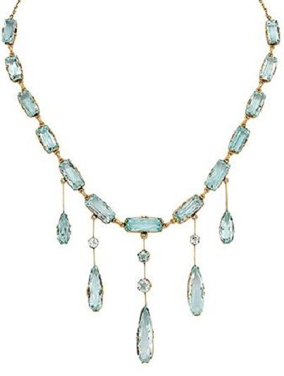 An Antique Aquamarine and Gold Necklace, circa 1910.  Centring a knife-edge fringe set with round and elongated pear-shaped aquamarines, suspending from a graduated row of rectangular aquamarines joined to a trace linking chain, mounted in 14k gold, with Russian assay marks and maker's mark for Vassili Efimovitch Baladanov. #EfimovitchBaladanov #antique #necklace