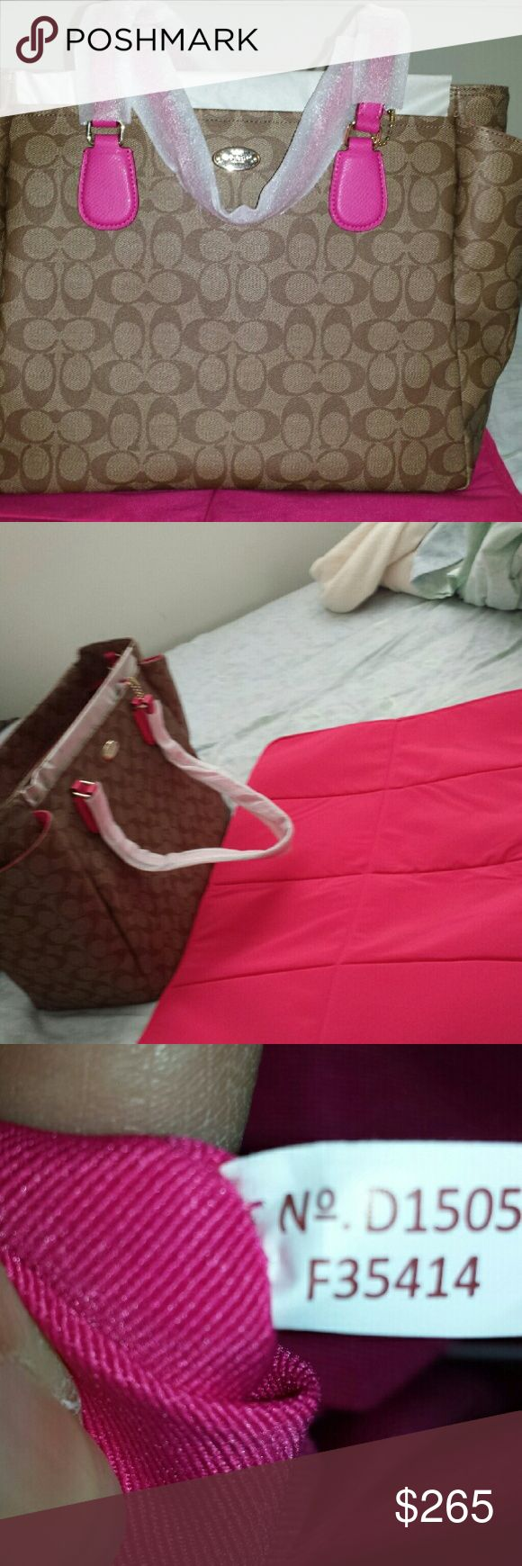 NWT Coach diaper bag with changing pad NWT Coach diaper bag in khaki/pink ruby coated canvas. Comes with removable long strap and changing pad. Coach Bags