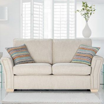 Cute classic sofa bed with scatter cushions and wood/chrome feet. Custom  options available