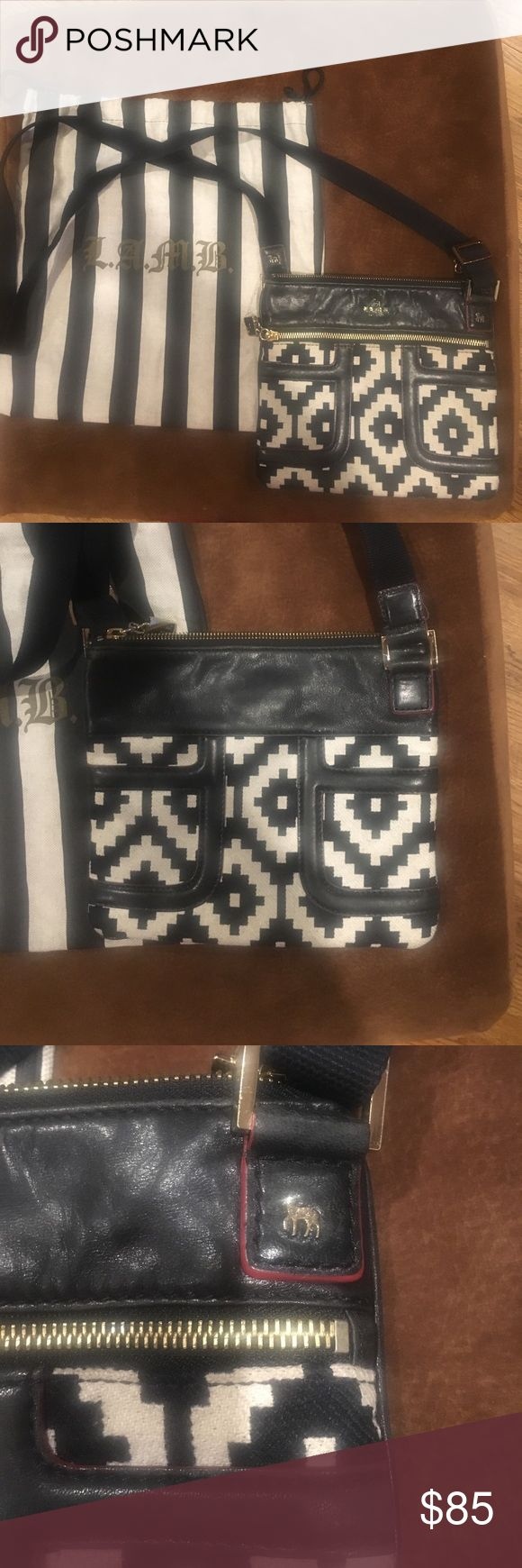 Lamb black and white crossbody bag Beautiful Lamb (by GwenStefani) crossbody messenger bag with leather detail. Preowned in good condition. lamb Bags Crossbody Bags